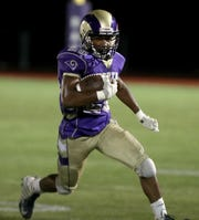 Clarkstown North's Chris Jean-Paul carries the ball during a game with Sleepy Hollow at Clarkstown North Sept. 27, 2019. Clarkstown North won 35-7.