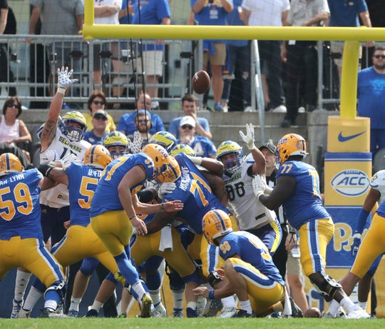 Pitt's Alex Kessman gives Pitt a 10-7 lead late in the second quarter with a 21-yard  at Heinz Field Saturday.