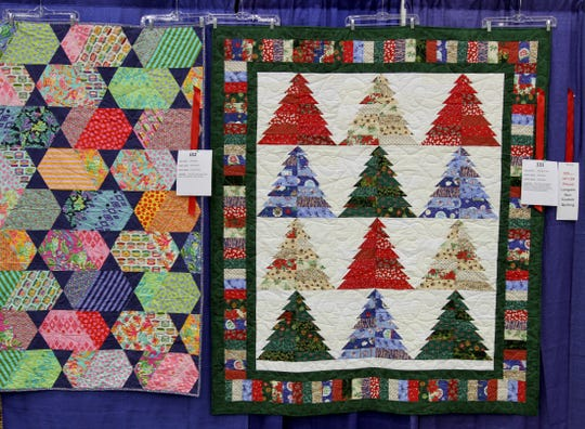 Quilts are hang for judging Saturday, Sept. 28, 2019, at the Red River Quilters' Guild Quilt Show in the Ray Clymer Exhibit Hall.
