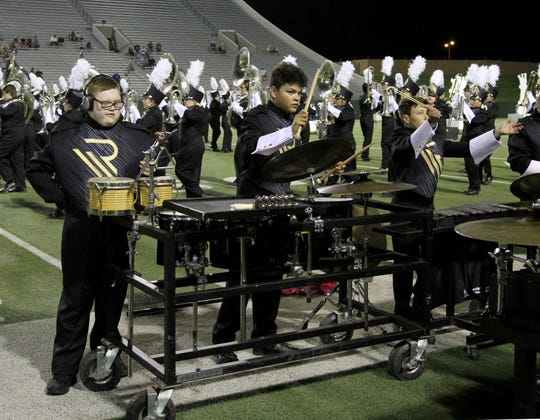 Jackson Sons plays the triangle during the Rider High School marching band halftime show Friday, Sept. 27, 2019, at Memorial Stadium.