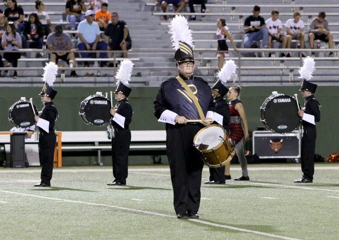 The Rider High School marching band performs their halftime show Friday, Sept. 27, 2019, at Memorial Stadium.