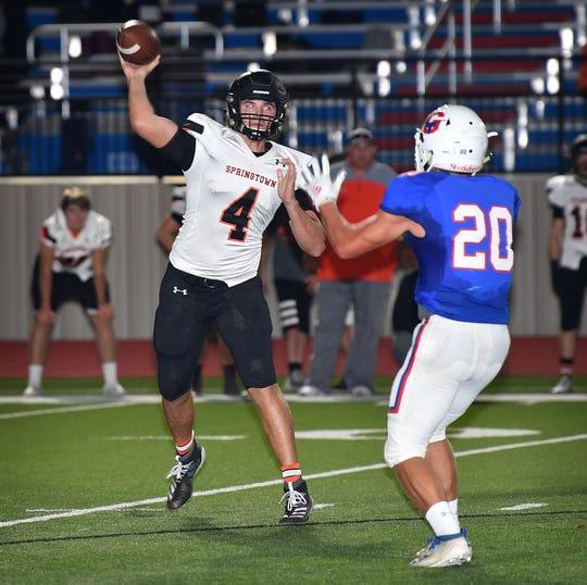 Springtown quarterback Camden Chesney (4) throws under pressure from Graham linebacker Raider Horn (20). Horn blocked the pass.