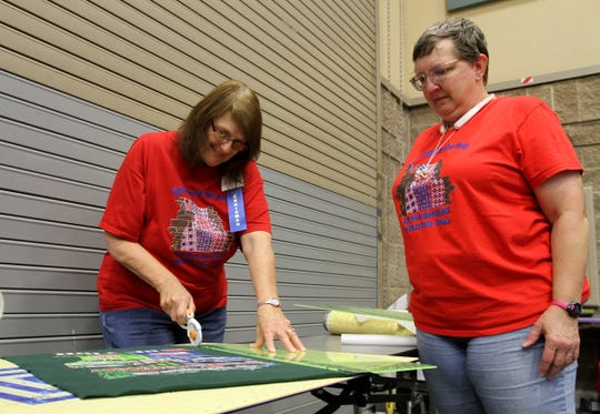 Audrey Bee, left, gaves a demonstration on tshirt quilts as Ginger Metcalf looks on Saturday, Sept. 28, 2019, at the Red River Quilters' Guild Quilt Show in the Ray Clymer Exhibit Hall.
