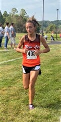 New Lex's Sydney Hambel runs in the Cambridge CC Invite on Saturday. She placed second in the girls small school division race.