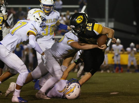 Philo defenders swarm Tri-Valley's Blake Sands during last week's game in Dresden. The Electrics knocked off perennial power Tri-Valley for the first time in 15 years. This week the Electrics will host Sheridan.