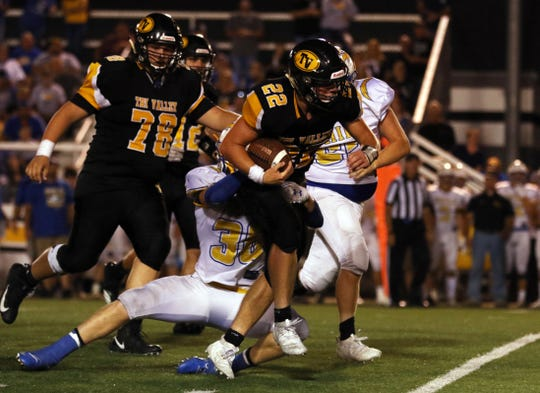 A Philo defender latches on to Tri-Valley's Blake Sands in that game a few weeks ago. Sands is coming off a school-record, seven-touchdown performance in a win over New Lex, as the Scotties head to Sheridan.