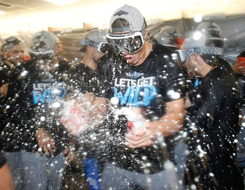 September 27: Tampa Bay Rays celebrates winning a wildcard spot after a win against the Toronto Blue Jays. It is Rays' first post-season appearance since 2013.