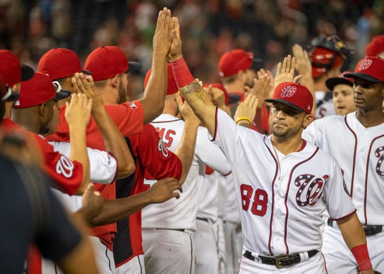 Center fielder Gerardo Parra (88) celebrates with his Nationals teammates after their victory against the Indians on Saturday.