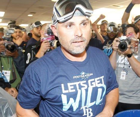 Lightning manager Kevin Cash heads for the celebration.
