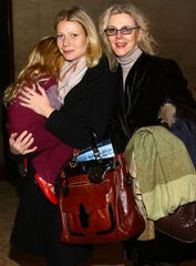 Actress Blythe Danner (R) accompanies her daughter actress Gwyneth Paltrow (C) holding her daughter Apple Martin as they attend the Nutcracker Family Benefit on December 8, 2007 in New York City.