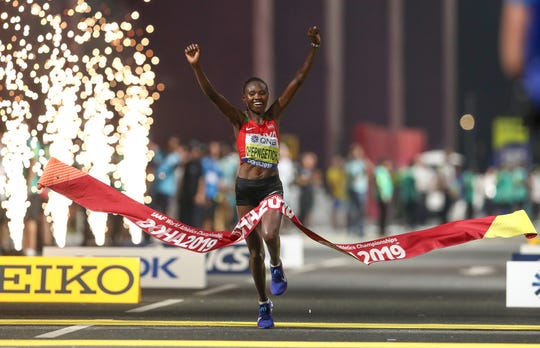 Ruth Chepngetich celebrates as she wins the women's marathon at the IAAF World Athletics Championships in Doha, Qatar.