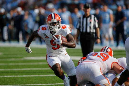 Clemson Tigers running back Travis Etienne runs for a touchdown against the North Carolina Tar Heels.