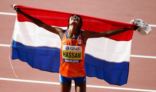 Sifan Hassan of the Netherlands celebrates after winning the women's 10,000-meter final.