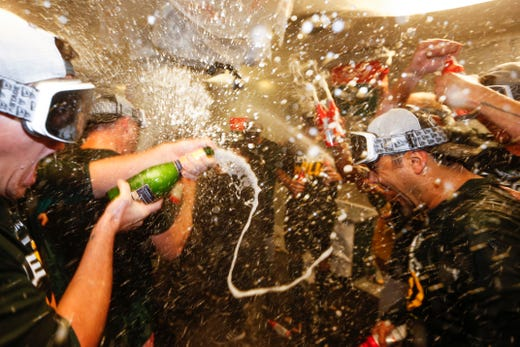 September 27: Oakland Athletics players celebrate after winning a wild card seat. They fell to the sailors, but conquered when the Indians lost.