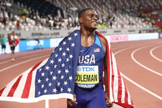 Christian Coleman celebrates after winning gold in the men's 100 meters.