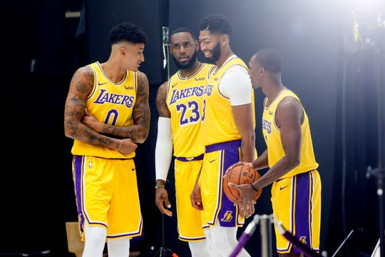 (From left to right) Kyle Kuzma, LeBron James, Anthony Davis and guard Rajon Rondo at Lakers media day on Friday.