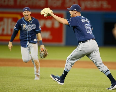 Rays pitcher Emilio Pagan (15) celebrates the final against the Toronto Blue Jays to secure a wild card spot.