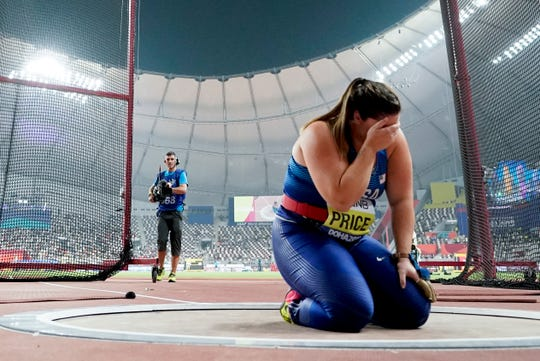Deanna Price breaks down at the throwing circle after winning the gold medal for the women's hammer throw.