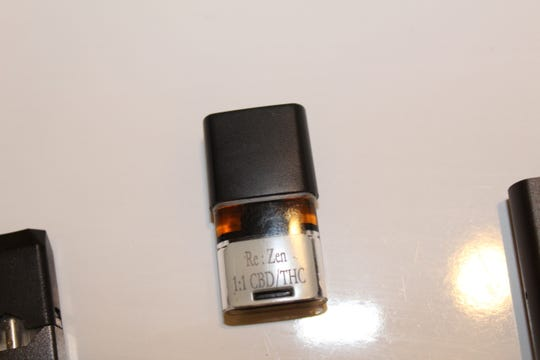 This vape cartridge contains equal amounts of cannabidiol (CBD) and tetrahydrocannabinol (THC), which is the psychoactive ingredient in marijuana.