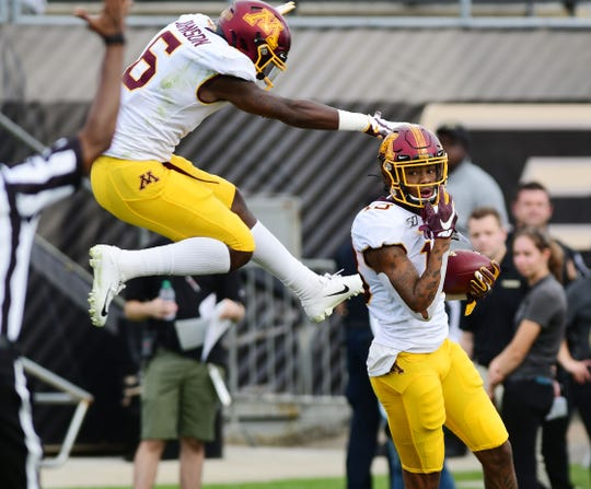 Minnesota Gophers reciever Rashod Bateman, right, celebrates with receiver Tyler Johnson after a first half touchdown against the Purdue Boilermakers  at Ross-Ade Stadium.