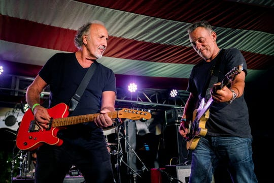 Bruce Springsteen joins Joe Grushecky and the Houserockers on stage at the opening party for the Springsteen: His Hometown at the Monmouth County Historical Association in Freehold on Saturday, Sept. 28.