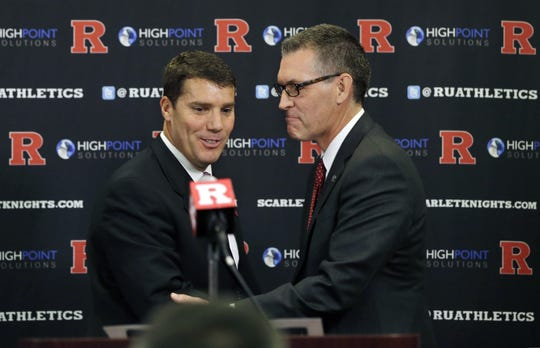Athletic director Pat Hobbs (right) hired Rutgers football coach Chris Ash in December of 2015.