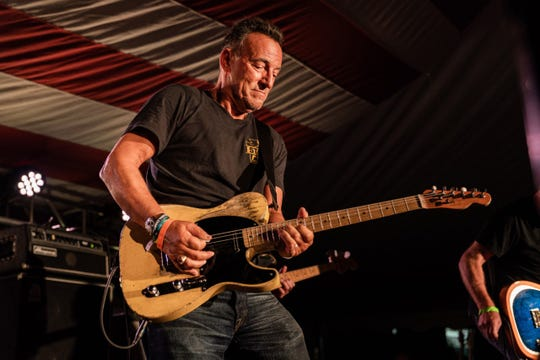 Bruce Springsteen joins Joe Grushecky and the Houserockers on stage at the opening party for the Springsteen: His Hometown at the Monmouth County Historical Society in Freehold on Saturday, Sept. 28.