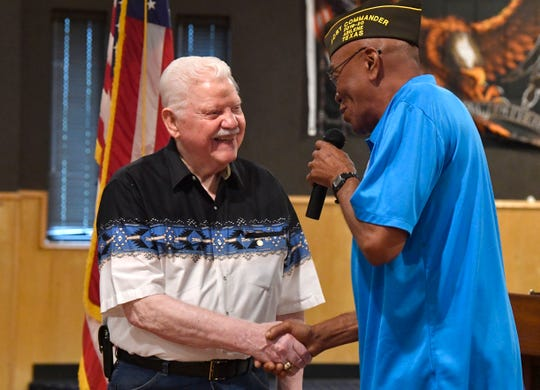 """William D. """"Doug"""" Bell, 89, is congratulated by Rodell Whitmore, the VFW Post No. 6873 post commander, Sunday during the anniversary celebration of the organization's 120th year. Bell's birthday also was Sunday and he was awarded with a retirement pin."""