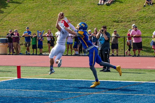 Victor Arciolla from Forks intercepts the ball intended for Jack McFadden in the end zone to stop a Maine Endwell score Saturday at the Maine Endwell Homecoming game.