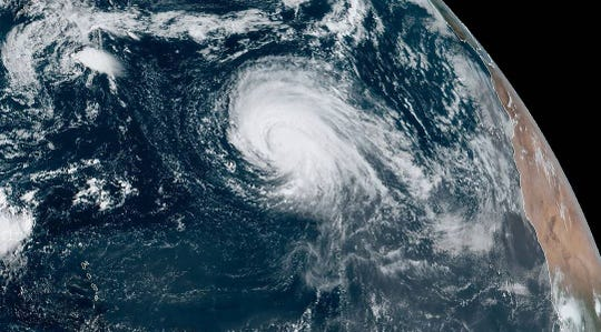 An image captured by the GOES-E weather satellite shows powerful Hurricane Lorenzo over the central Atlantic Ocean.