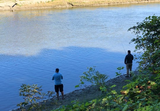 Two anglers cast from the bank of the Winooski near The Salmon Hole in Burlington on Sunday, Sept. 29, 2019.