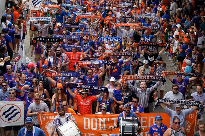 FC Cincinnati supporters march prior to the start of a game in September 2019 at Nippert Stadium.