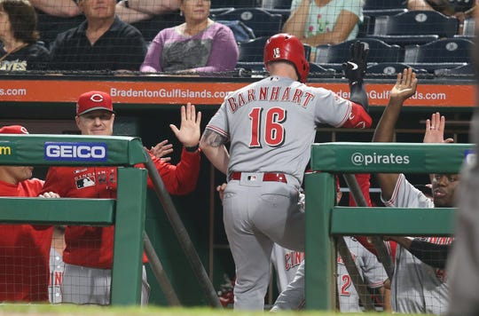 Sep 28, 2019; Pittsburgh, PA, USA;   Cincinnati Reds catcher Tucker Barnhart (16) high fives at the dugout after hitting a solo home run against the Pittsburgh Pirates during the second inning at PNC Park. Mandatory Credit: Charles LeClaire-USA TODAY Sports