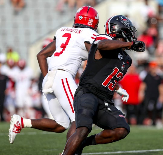 Austin Peay defensive back Kordell Jackson (13) looks to block a potential pass to Jacksonville State's Jerad Washington (3) in Saturday's game.