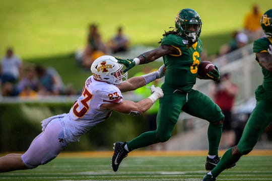 Sep 28, 2019; Waco, TX, USA; Baylor Bears running back JaMycal Hasty (6) stiff arms Iowa State Cyclones linebacker Mike Rose (23) during the second half at McLane Stadium.