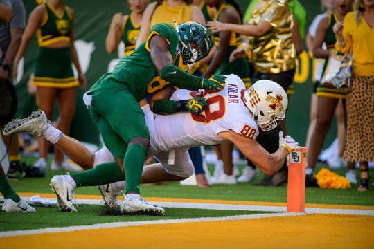 Sep 28, 2019; Waco, TX, USA; Iowa State Cyclones tight end Charlie Kolar (88) scores the go ahead touchdown as Baylor Bears safety Henry Black (8) defends during the second half at McLane Stadium.