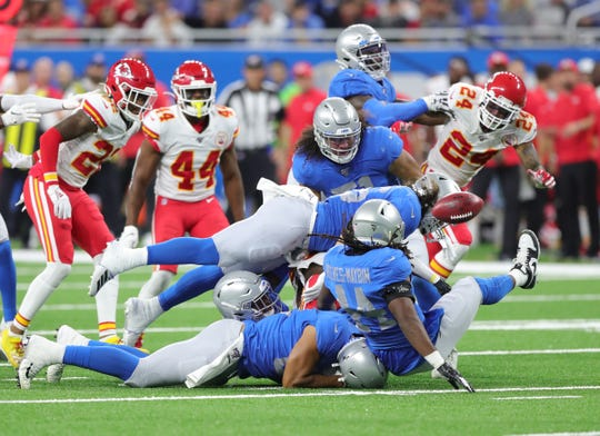 Lions linebacker Jalen Reeves-Maybin strips the ball away from Chiefs receiver De'Anthony Thomas during the first half Sunday, September 29, 2019 at Ford Field.
