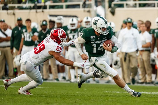 Michigan State quarterback Brian Lewerke runs against Indiana defensive back Khalil Bryant during the second half at Spartan Stadium in East Lansing, Saturday, Sept. 28, 2019.
