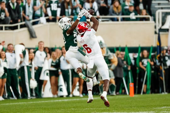 Josiah Scott gets called for pass interference while defending Indiana's Donavan Hale during the fourth quarter at Spartan Stadium.