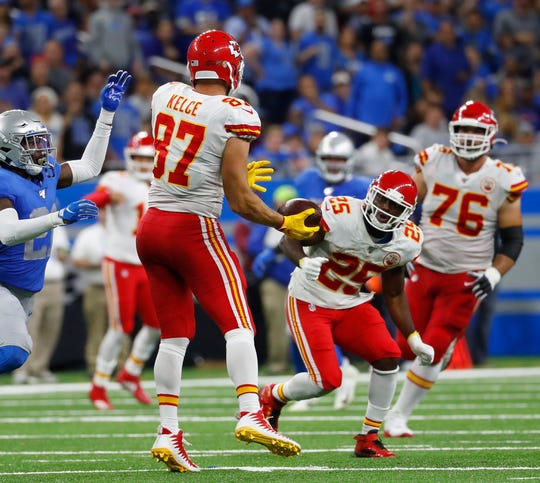 Chiefs tight end Travis Kelce laterals the ball to running back LeSean McCoy during the second half against the Detroit Lions on Sunday, Sept. 29, 2019, in Detroit.