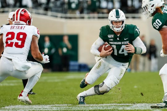 Michigan State quarterback Brian Lewerke runs against Indiana during the second half at Spartan Stadium in East Lansing, Saturday, Sept. 28, 2019.