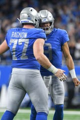 Lions quarterback Matthew Stafford and center Frank Ragnow celebrate the touchdown of wide receiver Kenny Golladay (not pictured) during the third quarter against Kansas City Chiefs at Ford Field on Sunday, September 29, 2019.