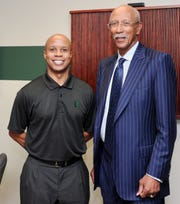 Rob Murphy and Dave Bing. Photo taken in the EMU locker room during Bing's visit with the team Nov. 1, 2011.