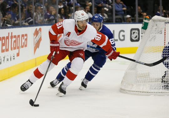 Detroit Red Wings forward Frans Nielsen (81) carries the puck past Toronto Maple Leafs forward Ilya Mikheyev (65) during the first period at Scotiabank Arena on Sept. 28, 2019.