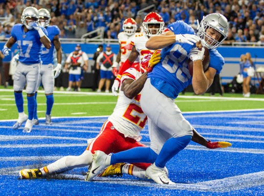 Detroit Lions tight end T.J. Hockenson catches the first touchdown pass as Kansas City Chiefs defensive back Bashaud Breeland tries to tackle him during the game against the Kansas City Chiefs, at Ford Field, Sunday, Sept. 29, 2019. The Lions lost, 34-30.