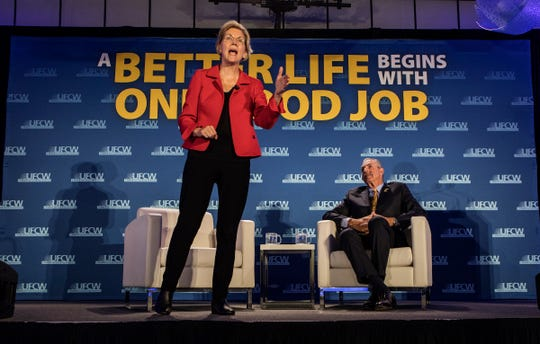 Presidential candidate and U.S. Senator Elizabeth Warren, D-Massachusetts, speaks as UFCW President Marc Perrone looks on Sunday at the UFCW 2020 Presidential Candidate Forum in Madison Heights.