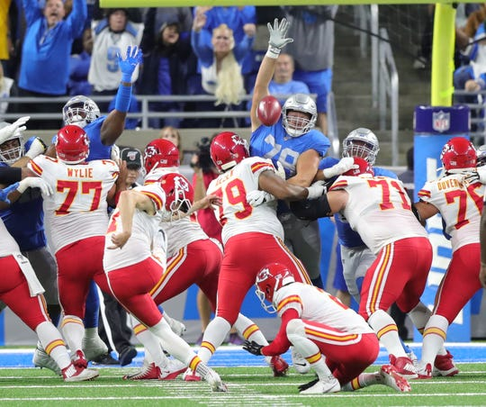 Detroit Lions defenders try to block a kick by Kansas City Chiefs kicker Harrison Butker during the first half Sunday, Sept. 29, 2019 at Ford Field.