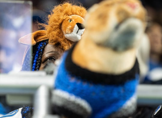 A Detroit Lions fan watches action against the Kansas City Chiefs at Ford Field, Sunday, Sept. 29, 2019. The Lions lost, 34-30.