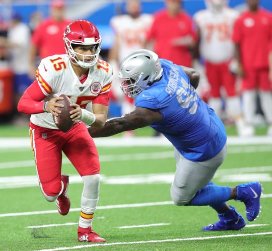 A'Shawn Robinson misses the tackle on Chiefs quarterback Patrick Mahomes during the second half Sunday.