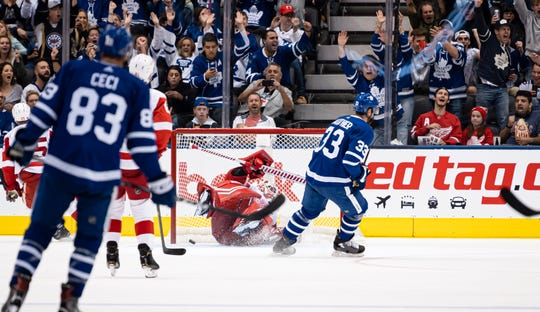 Toronto Maple Leafs left wing Trevor Moore (42) scores a goal on Detroit Red Wings goalie Jimmy Howard (35) during the second period of an NHL preseason hockey game in Toronto on Saturday, Sept. 28, 2019.